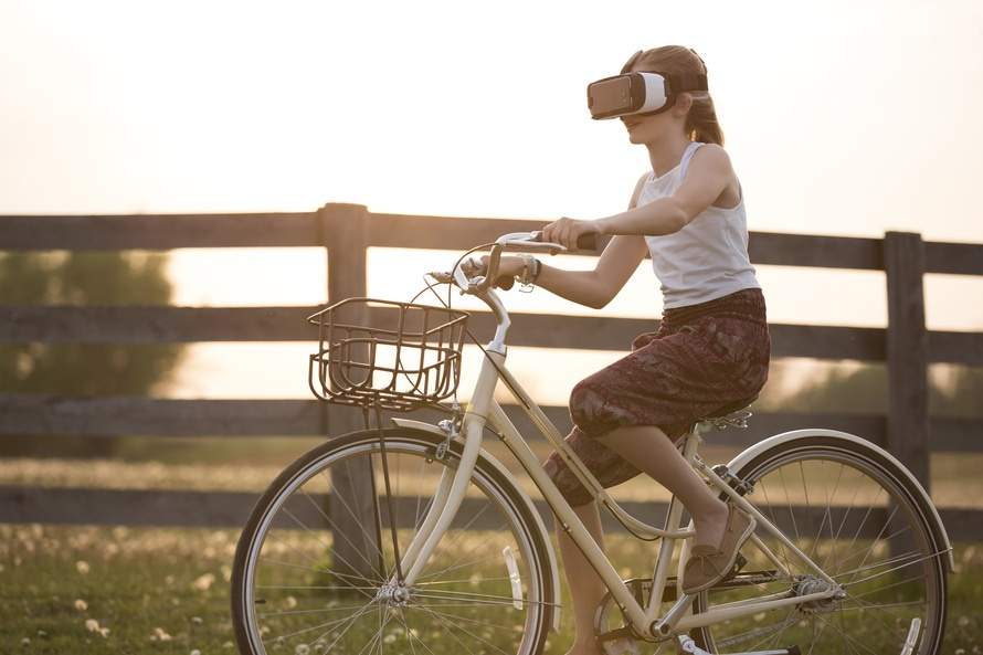 Girl virtual reality biking